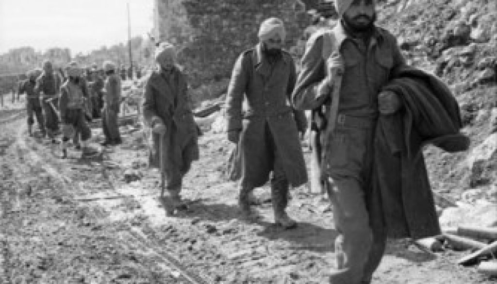 Indian-troops-pass-bomb-shattered-buildings-on-the-outskirts-of-Cassino-town-Italy